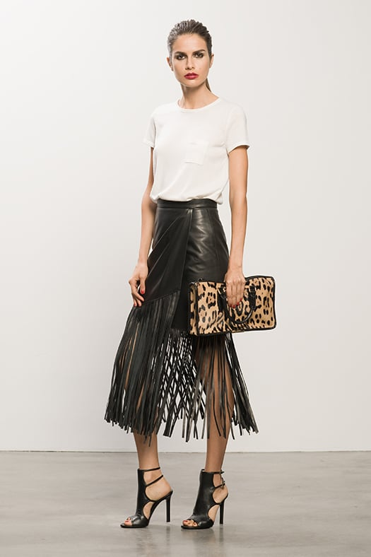 Cashmere Cream Tee ($295), Leather Black Fringe Skirt ($895), Bad Girl Black Sandal Bootie ($750), Diglam Leopard Pony Satchel ($1,195) Photo courtesy of Tamara Mellon