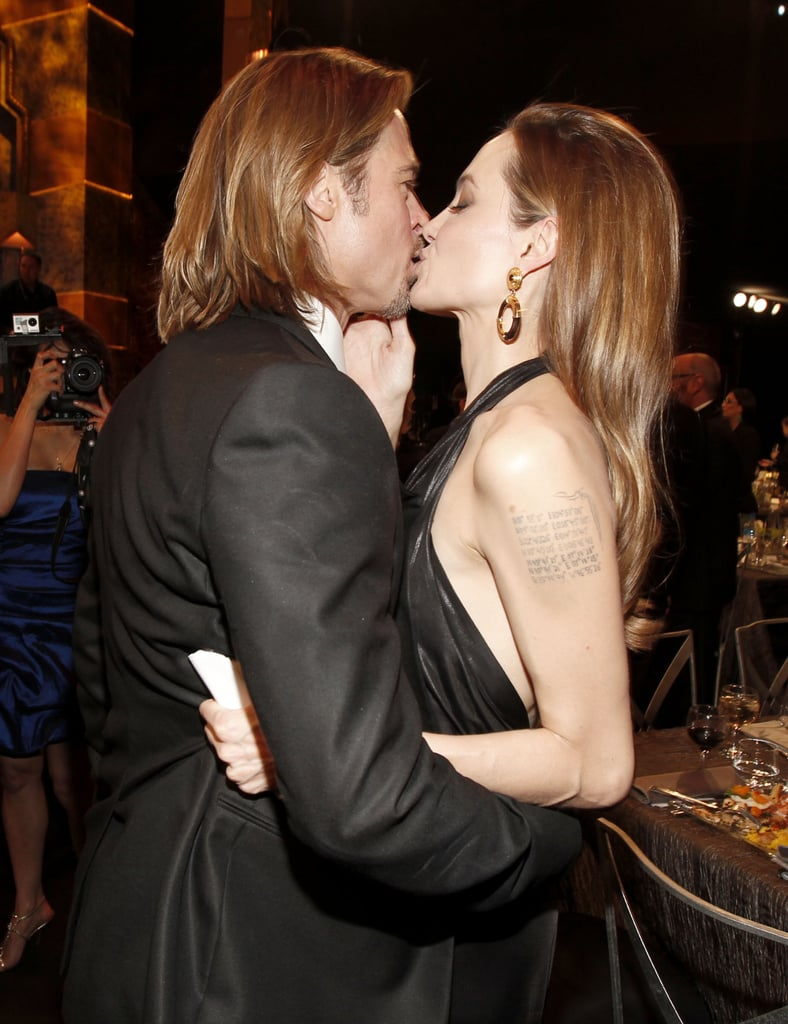 Brad and Angelina shared a kiss at the SAG Awards in January 2012.