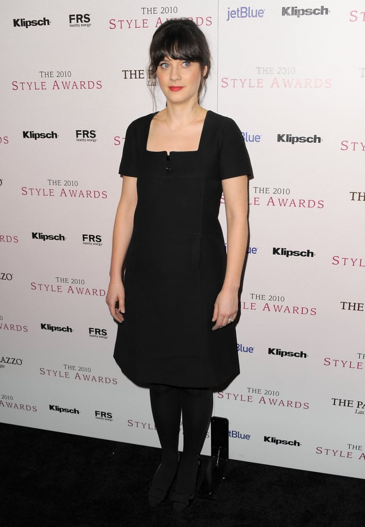 Zooey Deschanel kept things understated in a black sheath and tights.