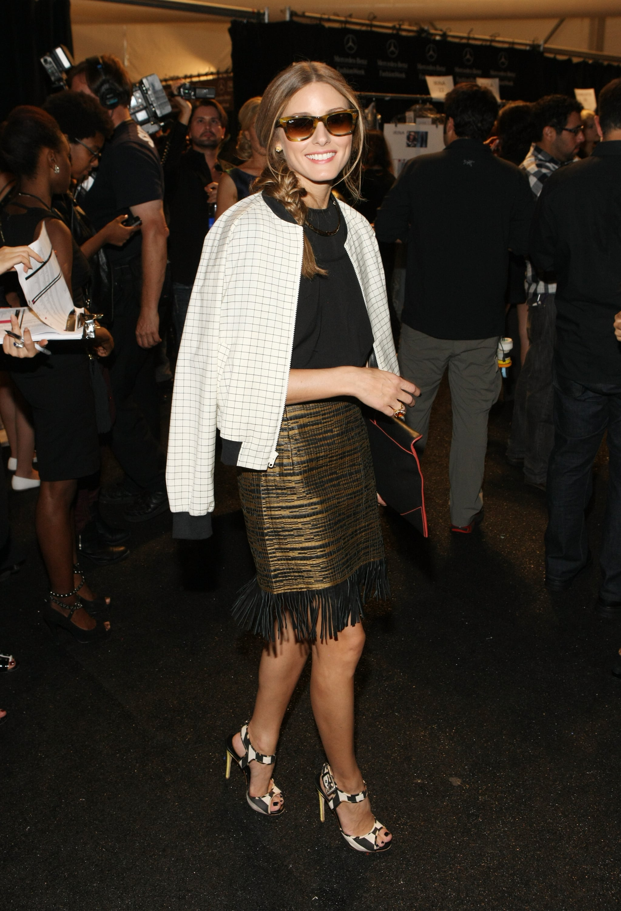 Who would have thought a windowpane baseball jacket would go so well with a fringed metallic skirt and heels?