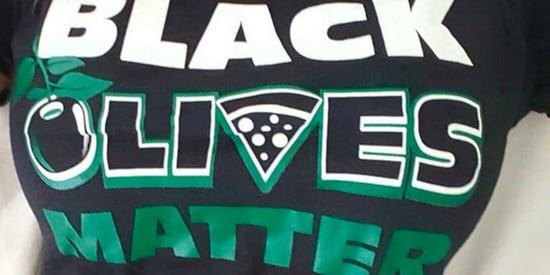 Restaurant Receives Backlash For Selling 'Black Olives Matter' Shirts