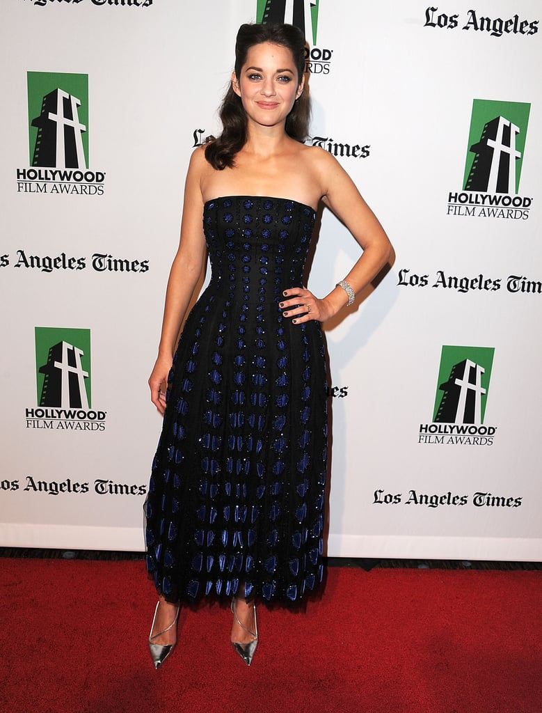 Marion Cotillard chose another strapless Christian Dior Fall 2012 Couture gown and silver metallic pumps at the Hollywood Film Awards gala in Beverly Hills.