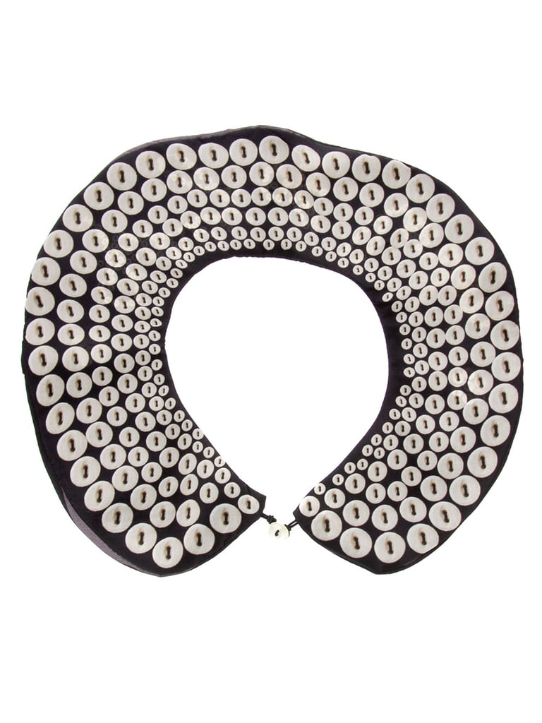 We'll just go ahead and say it: this kitschy collar is as cute as a button. Cleo Ferin Button Embellished Collar ($49)