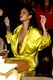 Rihanna wore a yellow frock with a plunging neckline.