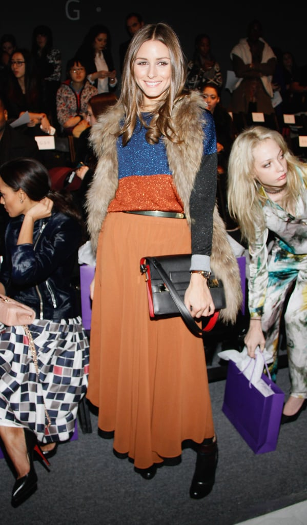 Olivia Palermo matched a burnt-orange maxi skirt with a sparkly sweater topped with a fur vest at the Noon by Noor show.