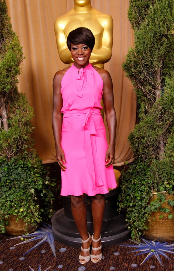 Viola Davis continues to stun on the red carpet — this shocking pink Juan Carlos Obando halter-style dress looked gorgeous on her. To complement this brightly hued number, she opted for nude Jimmy Choo heels.