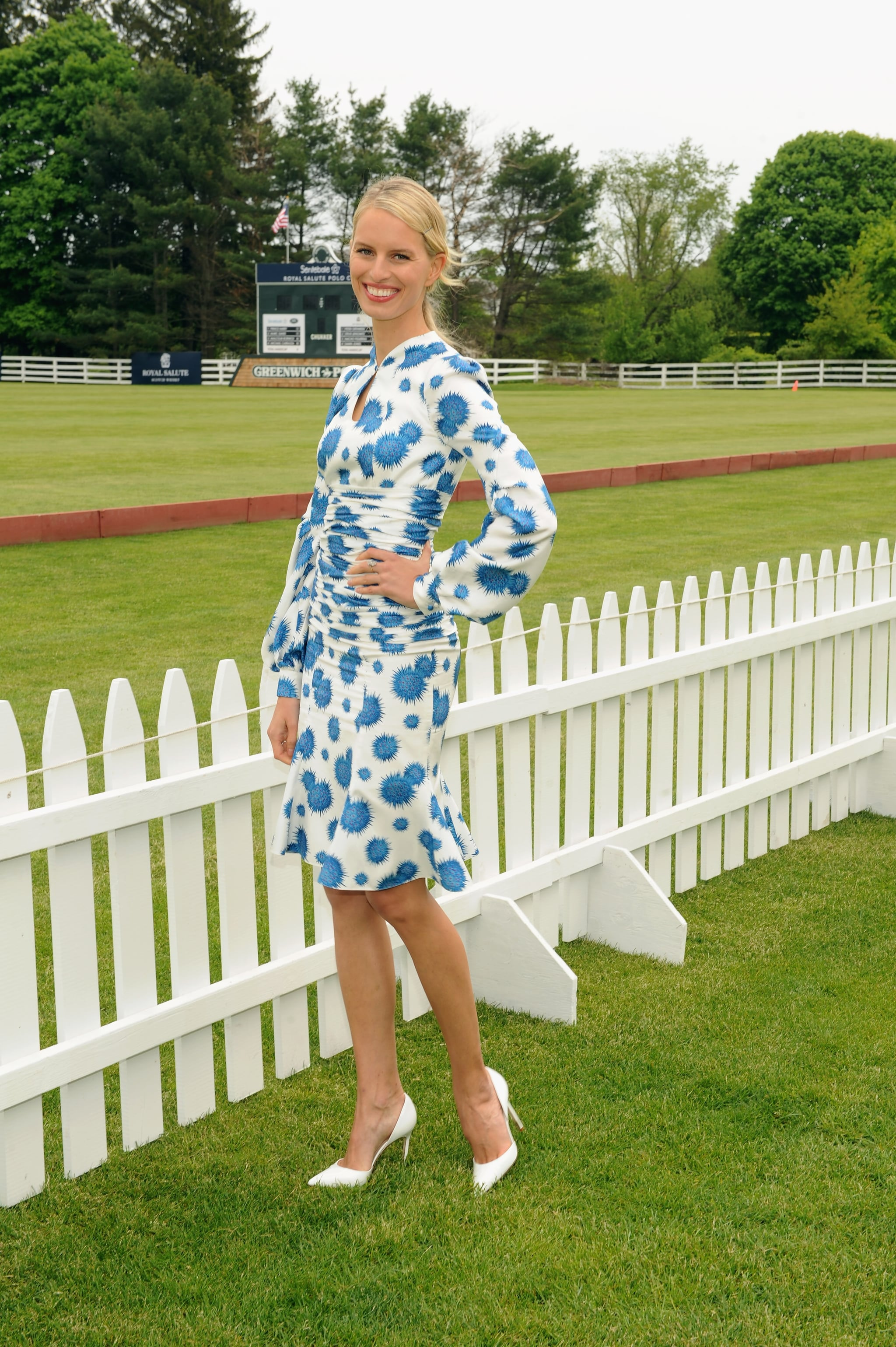 Karolina Kurkova matched a blue-and-white floral dress with clean white pumps at the 2013 Sentebale Royal Salute Polo Cup in Greenwich.