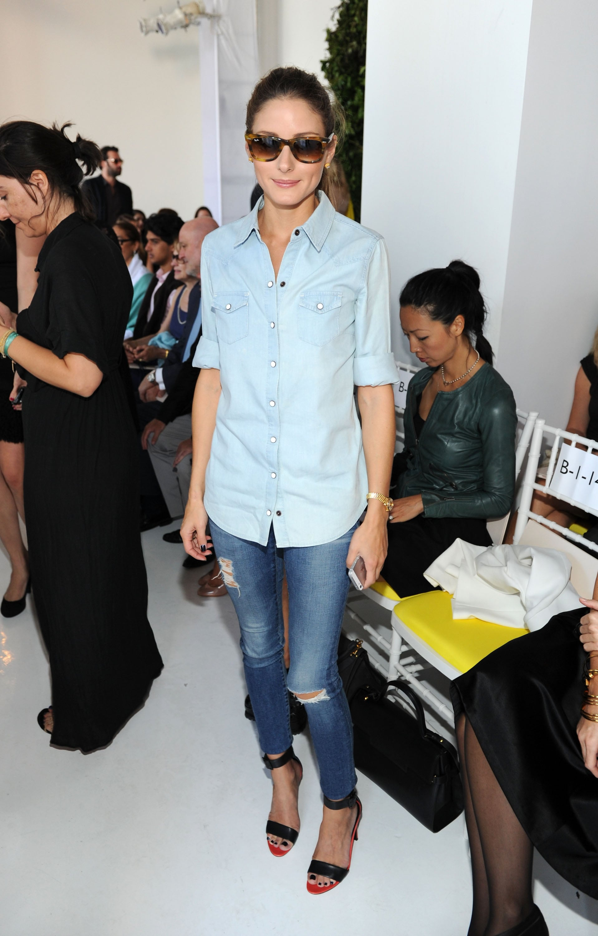 Olivia Palermo worked denim on denim with black ankle-strap sandals and retro sunglasses at Delpozo.