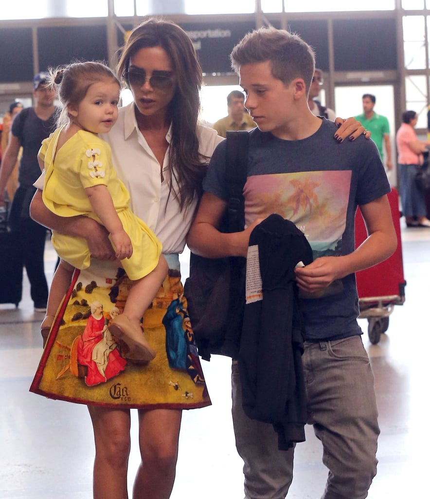 Victoria Beckham huddled up to Harper and Brooklyn before taking a flight out of LA on Saturday.