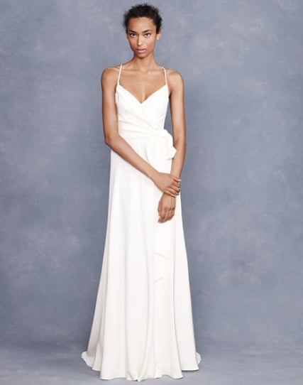 """Sometimes, the simplest wedding dress can make the most stunning impact. This elegant silk gown is super chic with its diminutive silk straps and faux wrap sash — perfect for a pretty garden or beach wedding."" — Chi Diem Chau, associate editor J.Crew Goddess Gown ($575)"