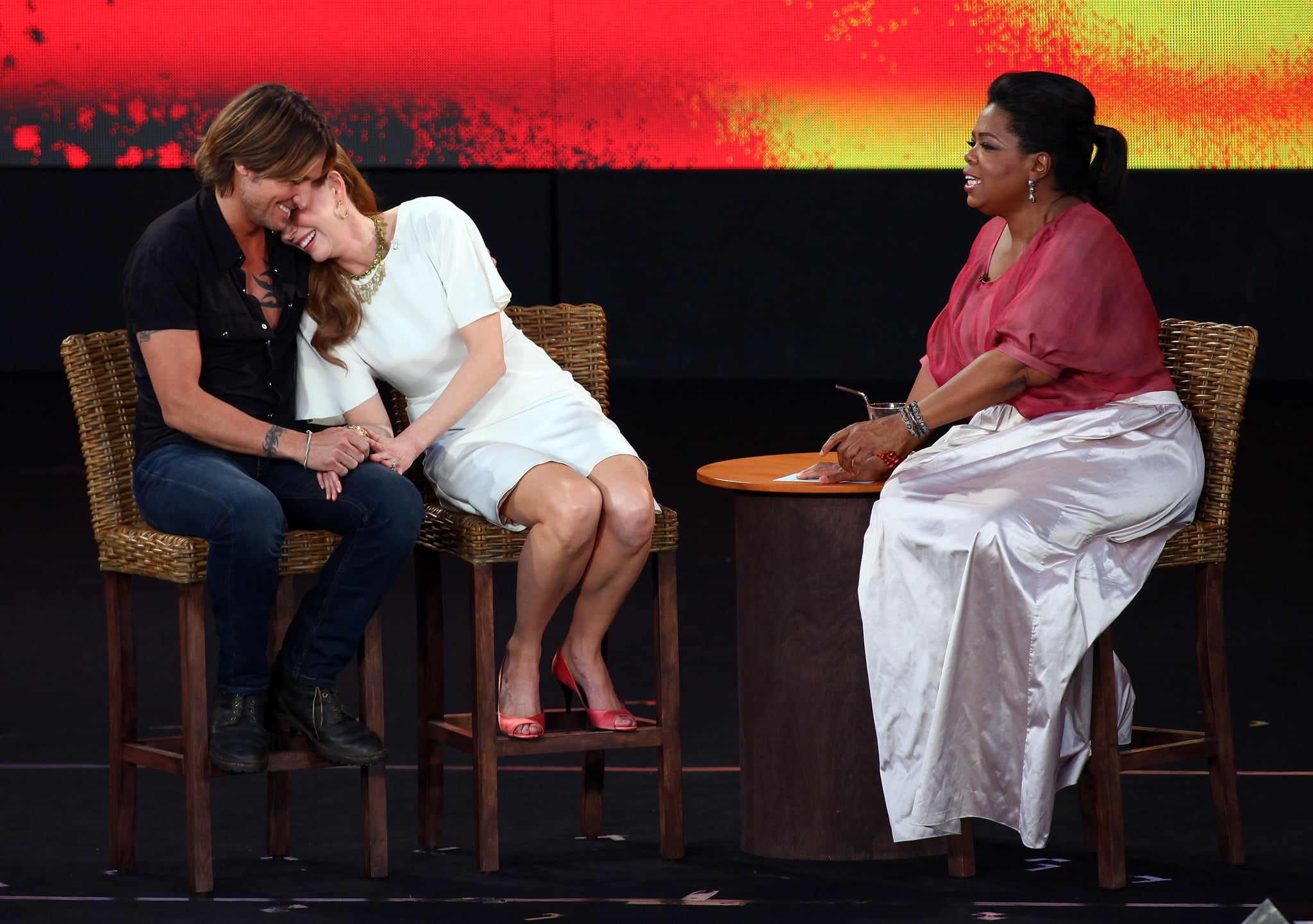 Nicole laughed onto Keith's shoulder while taping an interview with Oprah in Sydney back in December 2010.