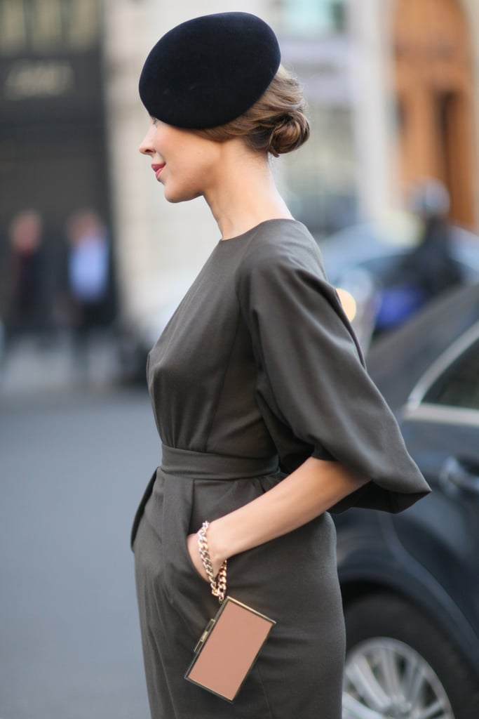 What better way to complete your look for Paris Fashion Week than with a beret? The gold minaudière was a glam accoutrement as well.