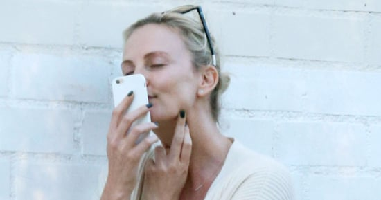 Charlize Theron Kisses the Little Guy in There