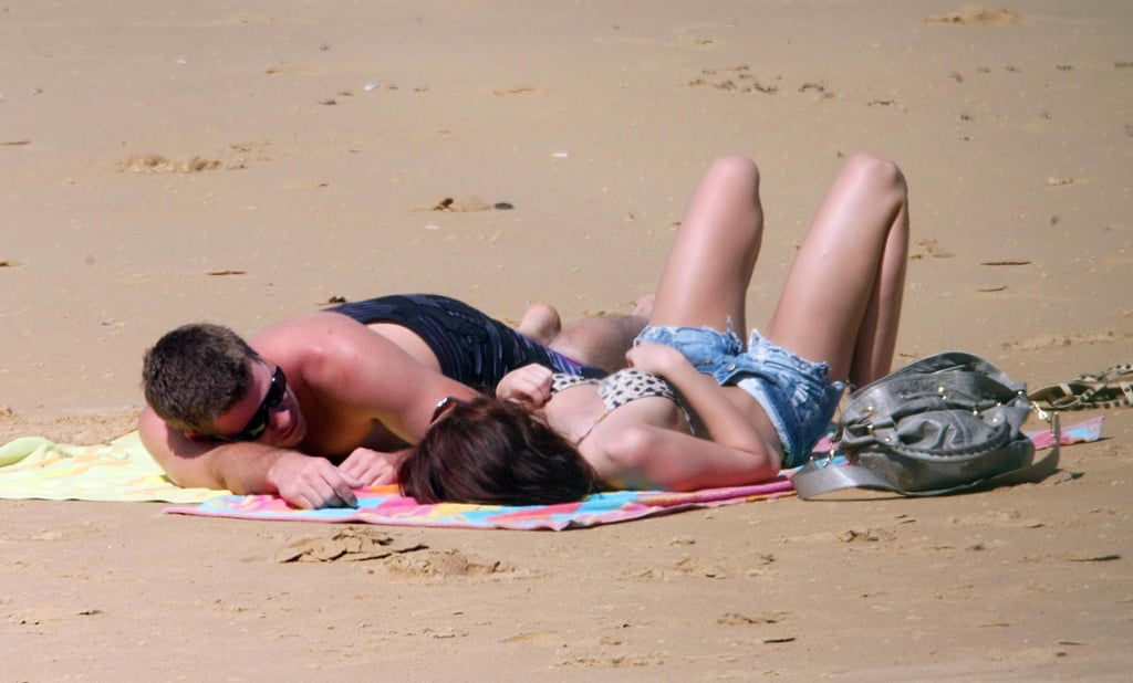 Miley Cyrus and Liam Hemsworth lounged on the beach in Australia in January 2010.