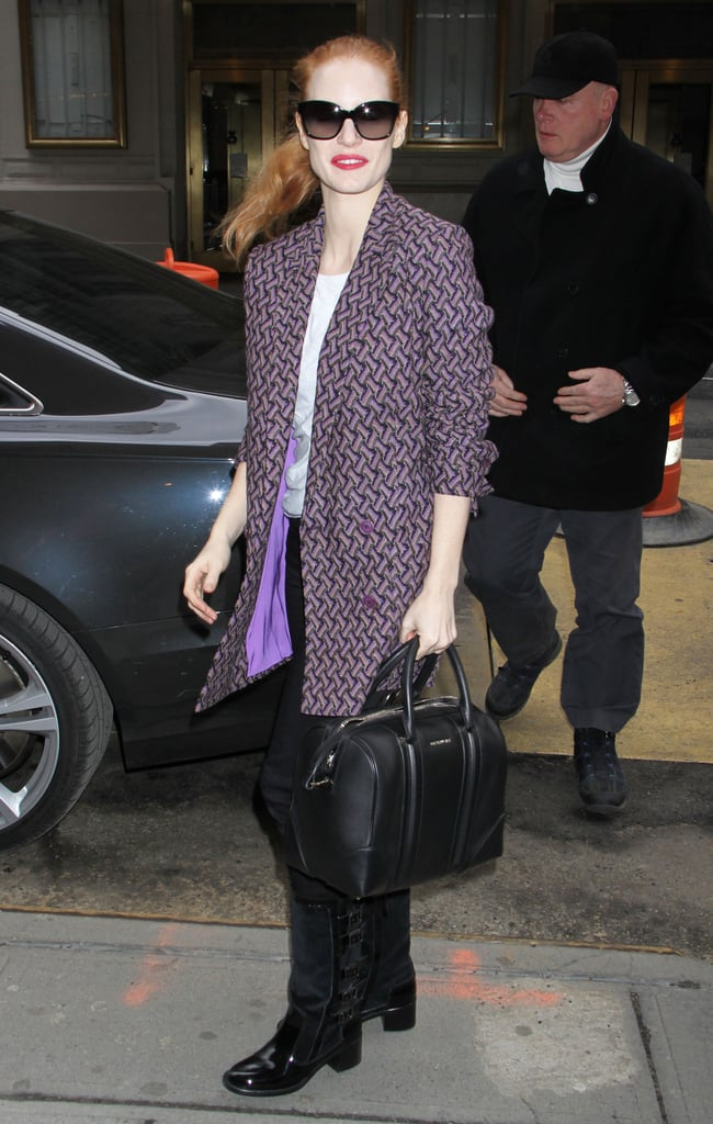 Jessica Chastain toted her black Givenchy Lucrezia bag with a print coat and black patent boots in NYC.