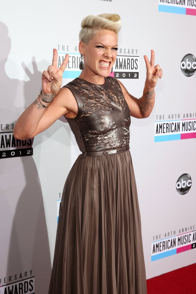Pink threw up a peace sign.