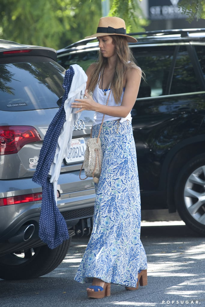 Jessica Alba embraced the warm LA weather in a printed Tory Burch maxi skirt, blue platform sandals, and a panama hat.