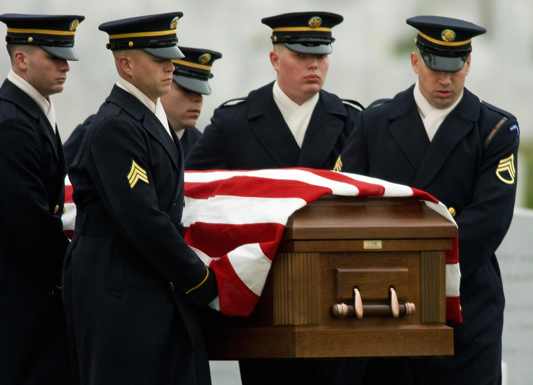 A US Army Honor Guard Casket Team carry the body of US Army Cpl. during funeral services in Arlington National Cemetery.