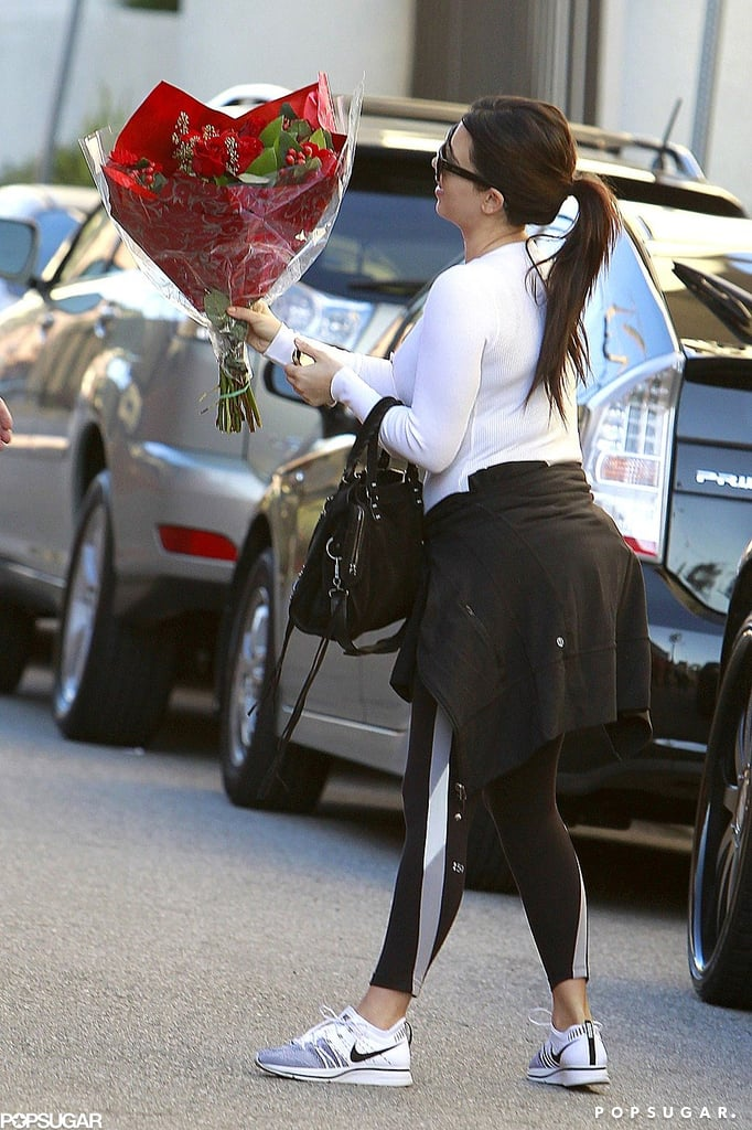 A pregnant Kim Kardashian carried a bouquet of red roses on her way to the gym in LA.