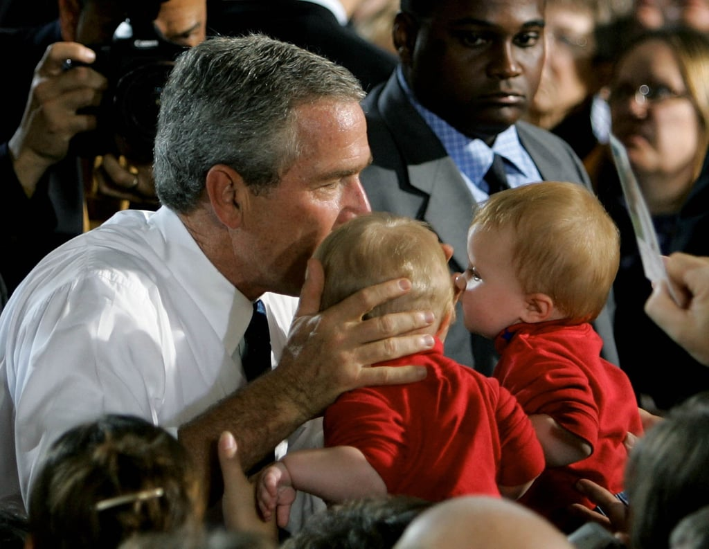 A father of twins himself, George W. Bush had no trouble reaching out to these twins during a 2004 stop in Onalaska, WI.