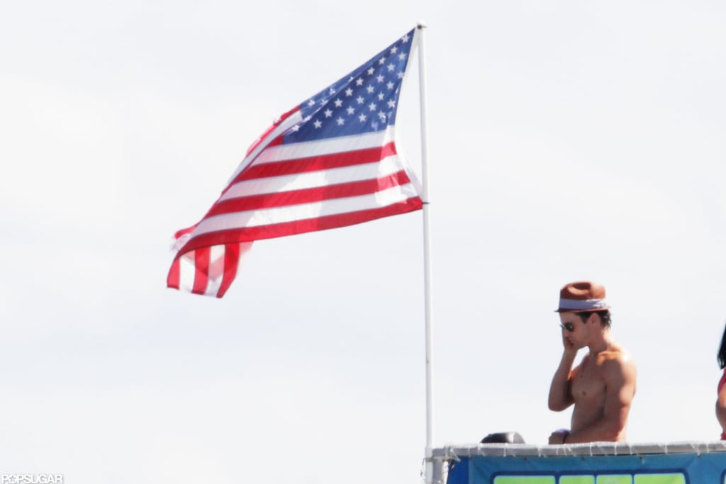 Matthew Bomer went shirtless on the deck of a boat in Miami while filming Magic Mike next to a flag in October 2011.