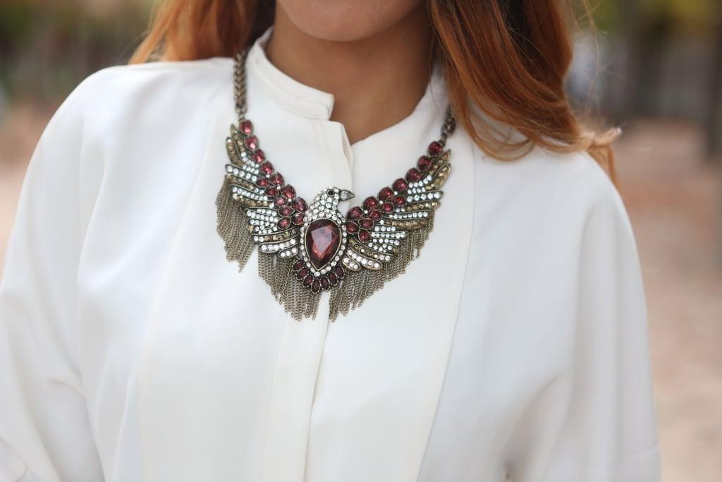 Bold jewels upgraded a basic blouse.