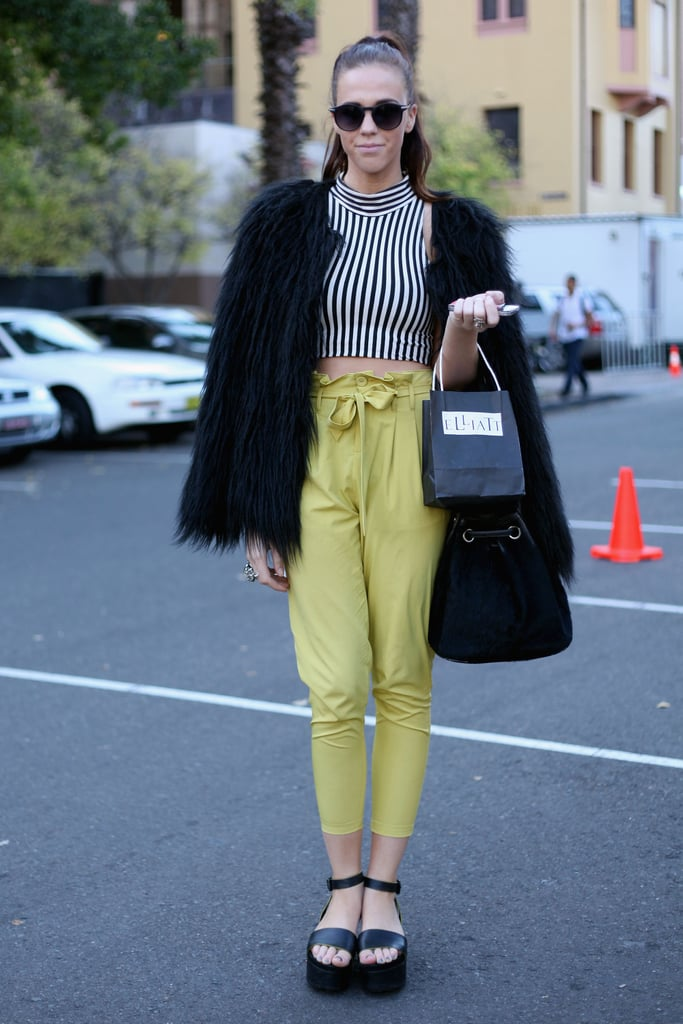 We like that this street styler played up some of Spring's most prevalent trends: stripes, bold colors, cropped silhouettes, and ankle-strap sandals.