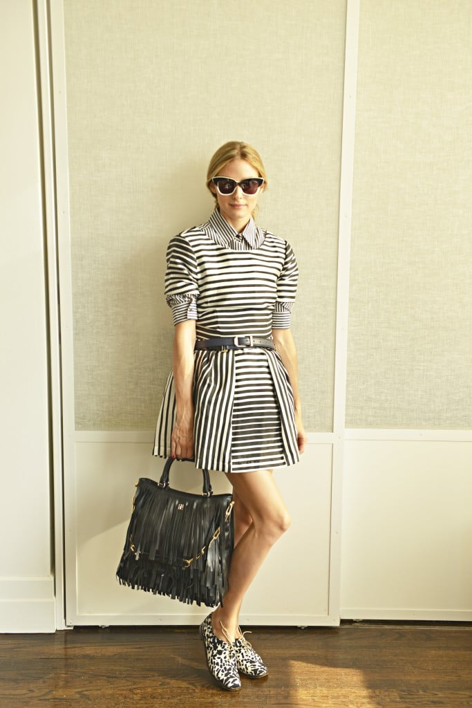 "Sure, a sleeveless striped dress could be an outfit all on its own, but Olivia added some serious mileage to the look with a striped button-down layered underneath plus a pair of printed Tibi oxfords for another pop of fresh print. While the dress on its own might have been perfect for a weekend, this smart style has ""office hours"" written all over it.  Source: Olivia Palermo"