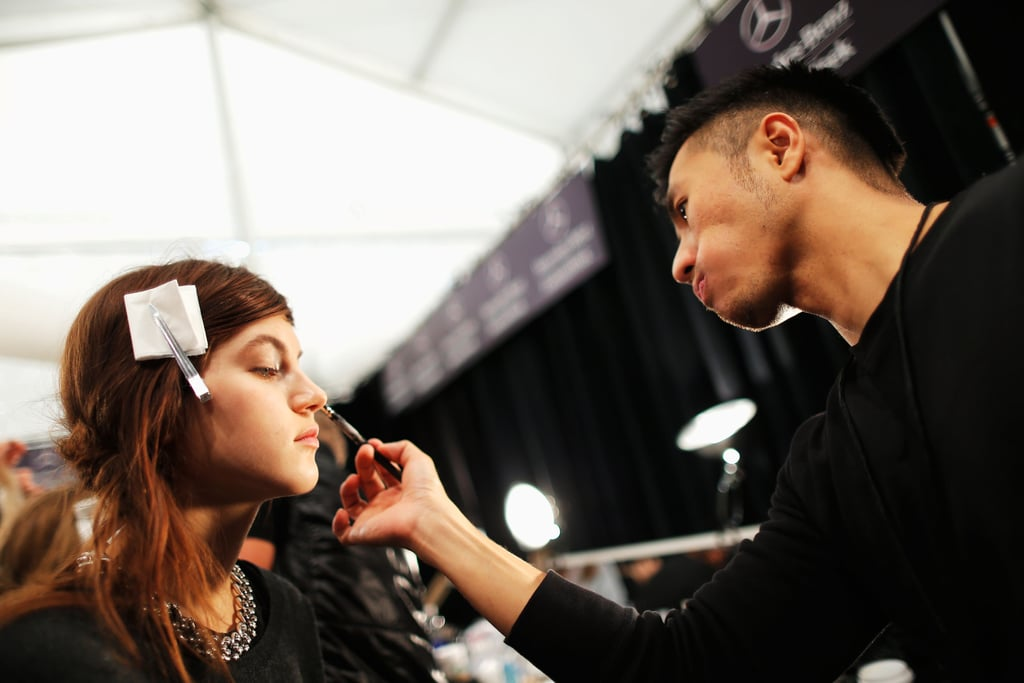 """He created the perfect bare skin look with Prep and Prime Skin Smoother ($30). """"It plumps up the skin, makes it a little matte, and has optical diffusers,"""" Bouchard explained.  For the ethereal eye, he used a shimmering silvery taupe from the Fall '13 Forecast Eyes palette, Superslick eyeliner in Nocturnal ($20), and White Pigment ($21). The lips were given a stain effect with Lipstick in Cyber ($15) blotted on and then darkened using Lip Pencil in Just My Type ($15)."""