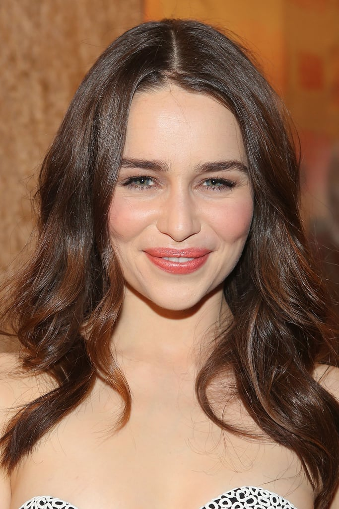 """When I'm working with younger actresses, it's always nice to keep them clean and fresh, so their own features show up and are not muted out,"" Chanel makeup artist Jillian Dempsey said. ""I wanted to keep her effortless-looking. Emilia has beautiful porcelain skin, so I didn't really need to cake on a ton of foundation or powder."" So Dempsey just added a thin layer of Chanel Vitalumière Aqua Ultra-Light Skin Perfecting Sunscreen Makeup ($45). To get her khaki-and-bronze eye makeup look, Dempsey outlined her peepers with Chanel Stylo Yeux Waterproof Long-Lasting Eyeliner in Khaki Précieux ($30), a khaki gold-green. She then layered on Chanel Limited Edition Quadra Eye Shadow in Séduction ($59). ""I didn't do a traditional smoky eye, but I wanted her eyes to have a little drama — to look ethereal, and worn in, and dewy, and luminescent,"" Dempsey explained. Her lashes were finished with Chanel Inimitable Mascara ($30) and short-length individual lashes on three quarters of her eye.  Emilia's lips were done up in Chanel Rouge Coco Hydrating Crème Lip Colour in Mystique ($34), a dusty rose color. ""I like to apply a nude lip liner, like Chanel Le Crayon Lèvres Precision Lip Definer ($29), after I put on the color so it doesn't look too perfect,"" said Dempsey. ""I call it my 'scribbling method': You put on your lipstick color with a brush, so it looks like you're staining the lips at first. Then you take your liner, and you push out on the upper corners of the mouth to build a shelf where you want the color to go, moving with the natural shape of the lips. Then you go back in with your lip color."""