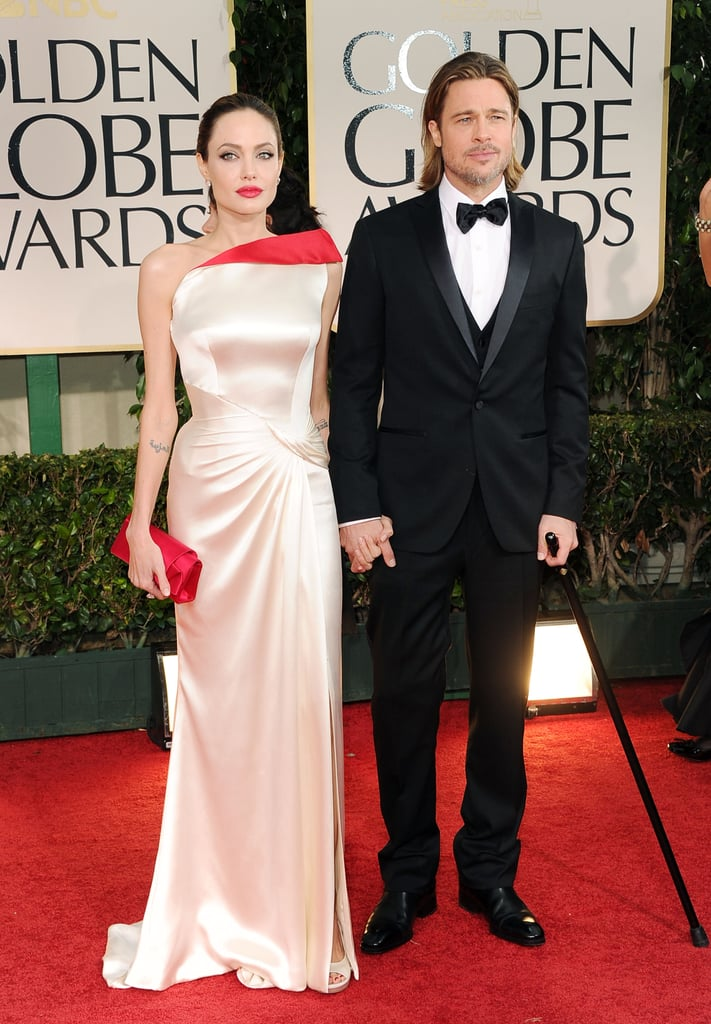 Brad Pitt and Angelina Jolie held hands on the red carpet.