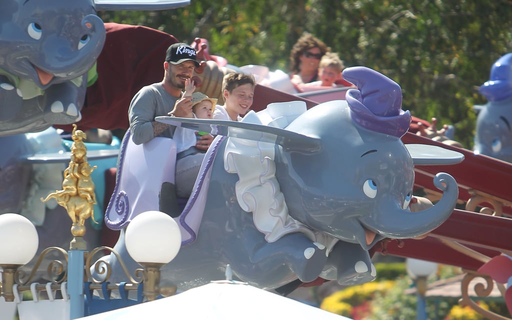 David Beckham took the kids on a flying Dumbo ride at Disneyland.