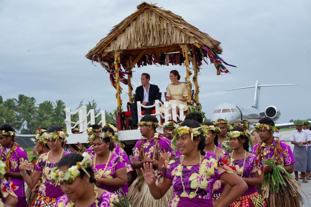 Kate Middleton and Prince William were carried to a welcoming ceremony in Tuvalu in September.