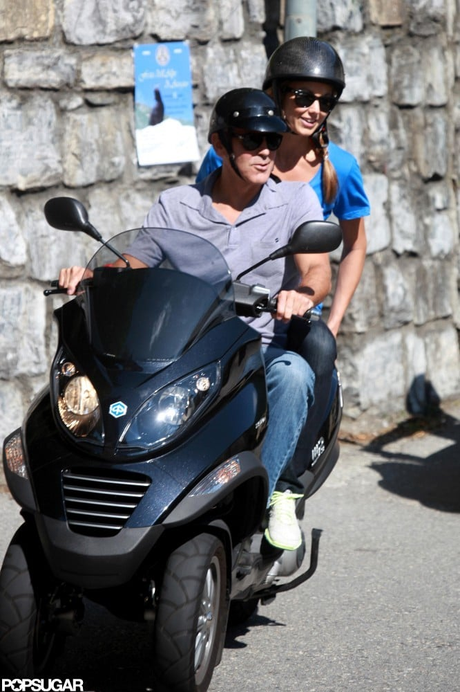 Stacy Keibler was all smiles during her scooter ride with George Clooney in Switzerland last month.