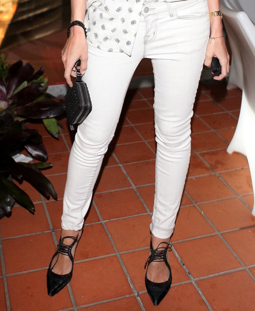 We love how she accented her ultralight ensemble with cool lace-up pointy-toe pumps and a studded black clutch.