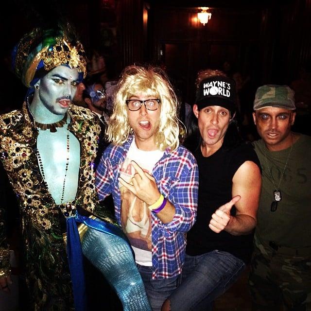 Lance Bass went as Garth from Wayne's World for Halloween, posing alongside Adam Lambert in his genie costume. Source: Instagram user lancebass