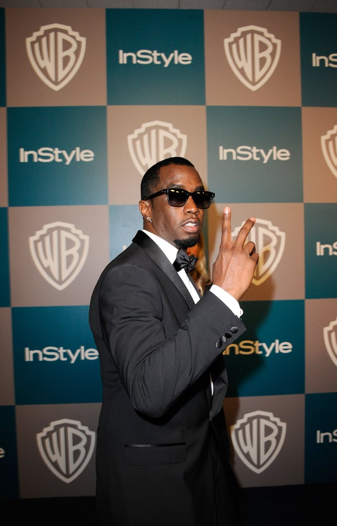 Diddy gave the peace sign on his way to  InStyle's Golden Globes afterparty.