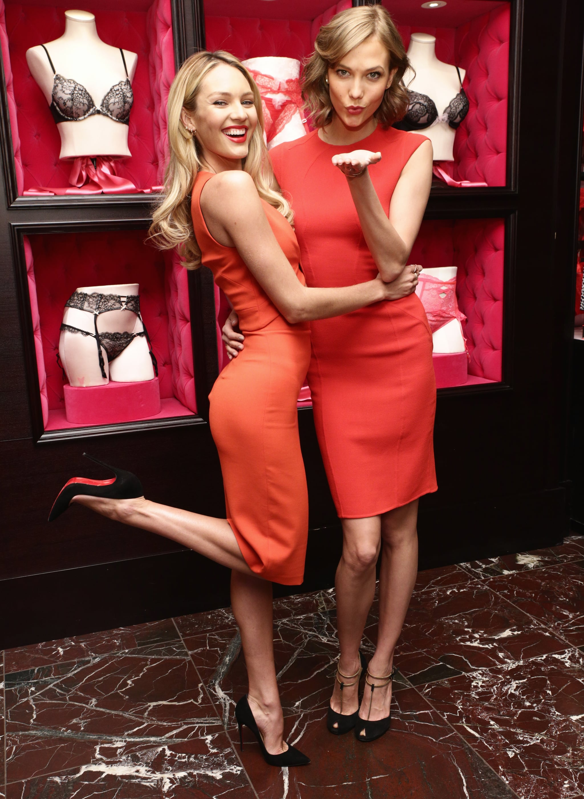 Candice Swanepoel in Robert Rodriguez and Karlie Kloss in Talbot Runhof at Victoria's Secret's Bombshell Day celebration.