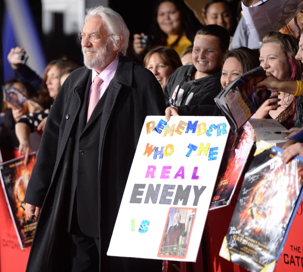 Donald Sutherland, aka President Snow, posed with a fan poster.