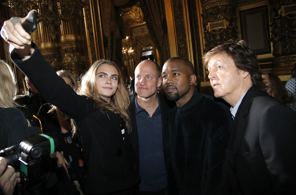 Cara Delevingne took a selfie with Woody Harrelson, Kanye West, and Paul McCartney at Stella McCartney's show during Paris Fashion Week in March 2015.