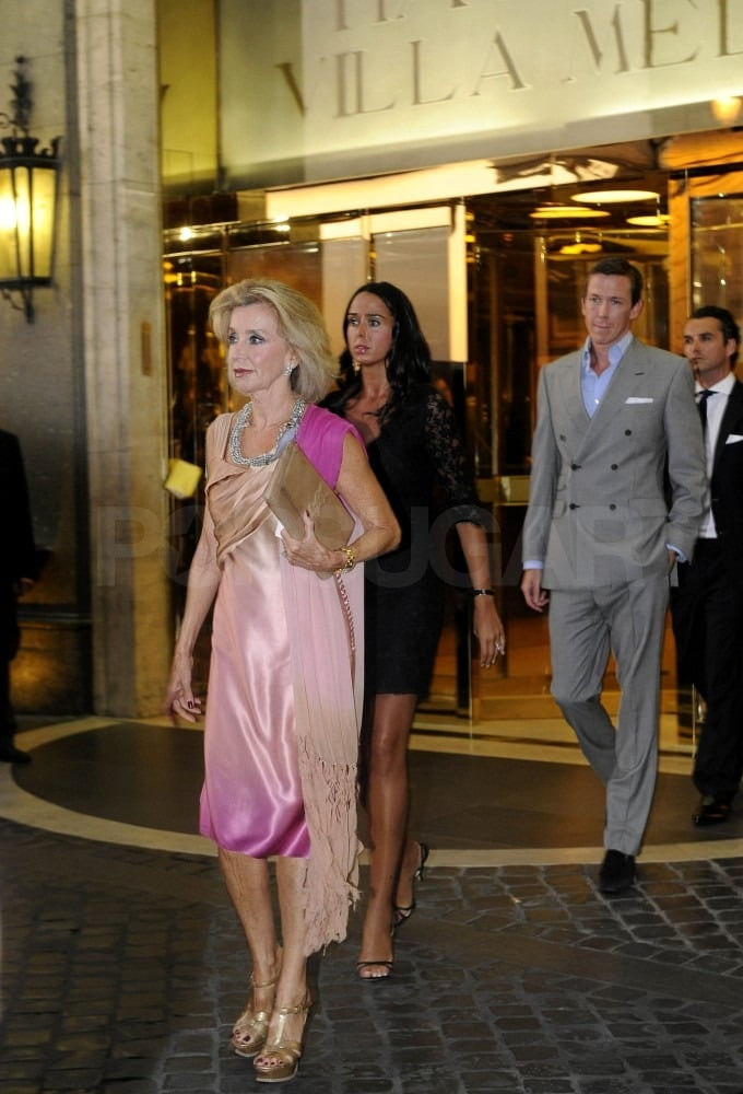 Guests filed out of their hotel on the way to the rehearsal dinner.