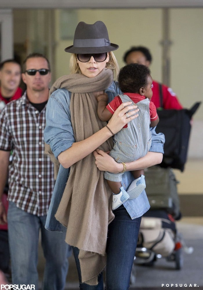 Charlize Theron carried her son, Jackson, through LAX.