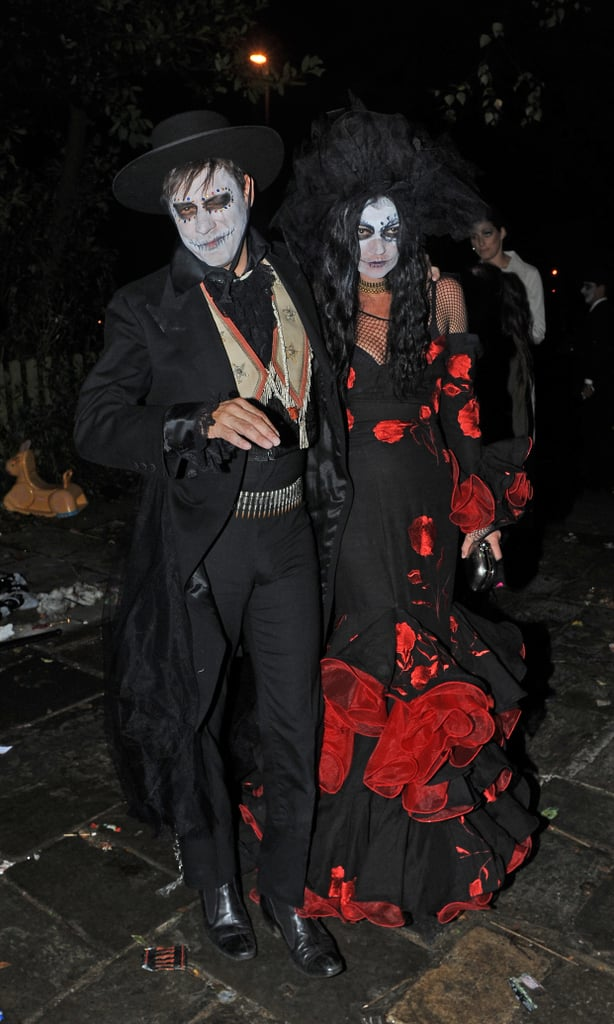 The couple donned spooky versions of Day of the Dead disguises, complete with ghoulish face paint, for British TV host Jonathan Ross's annual bash in London in 2013.