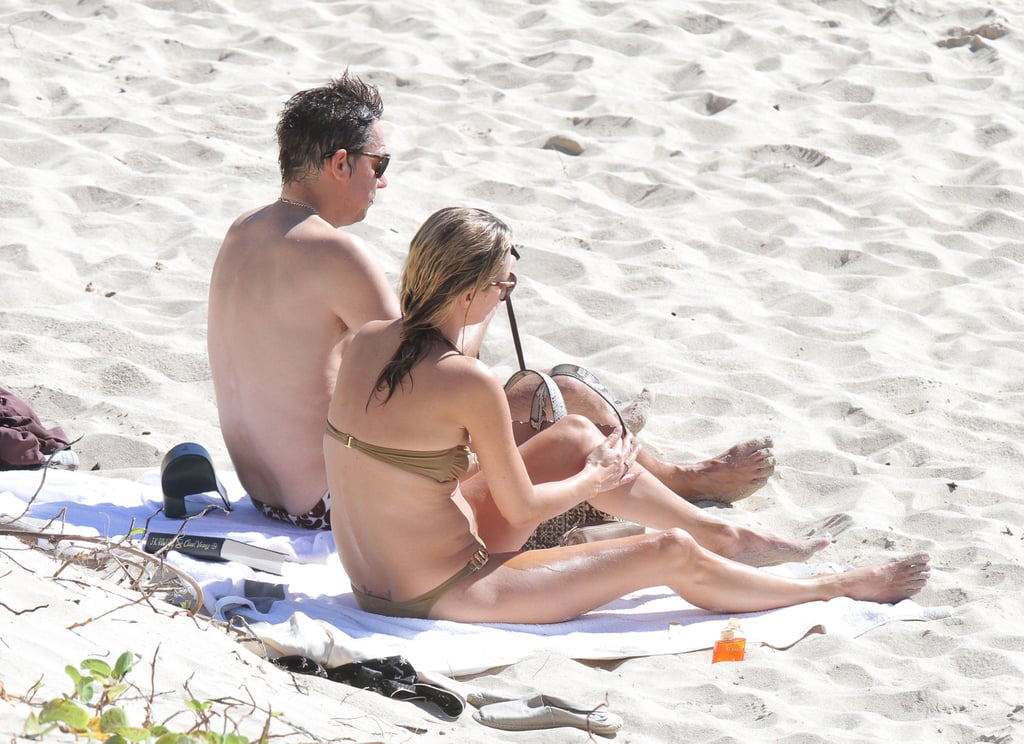 Kate Moss relaxed next to her husband.