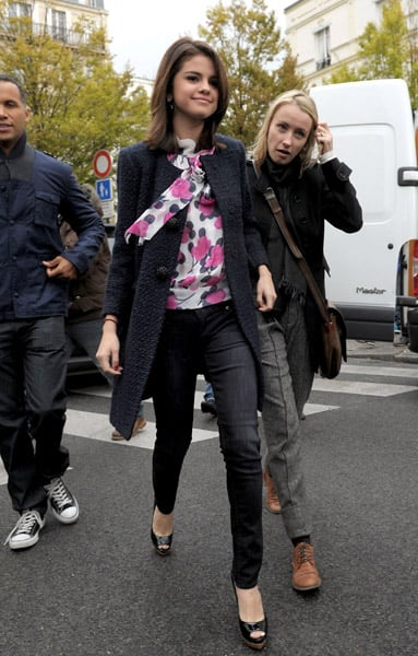France has turned Selena Gomez into quite the chic little thing. Love the pop of color via her floral blouse.