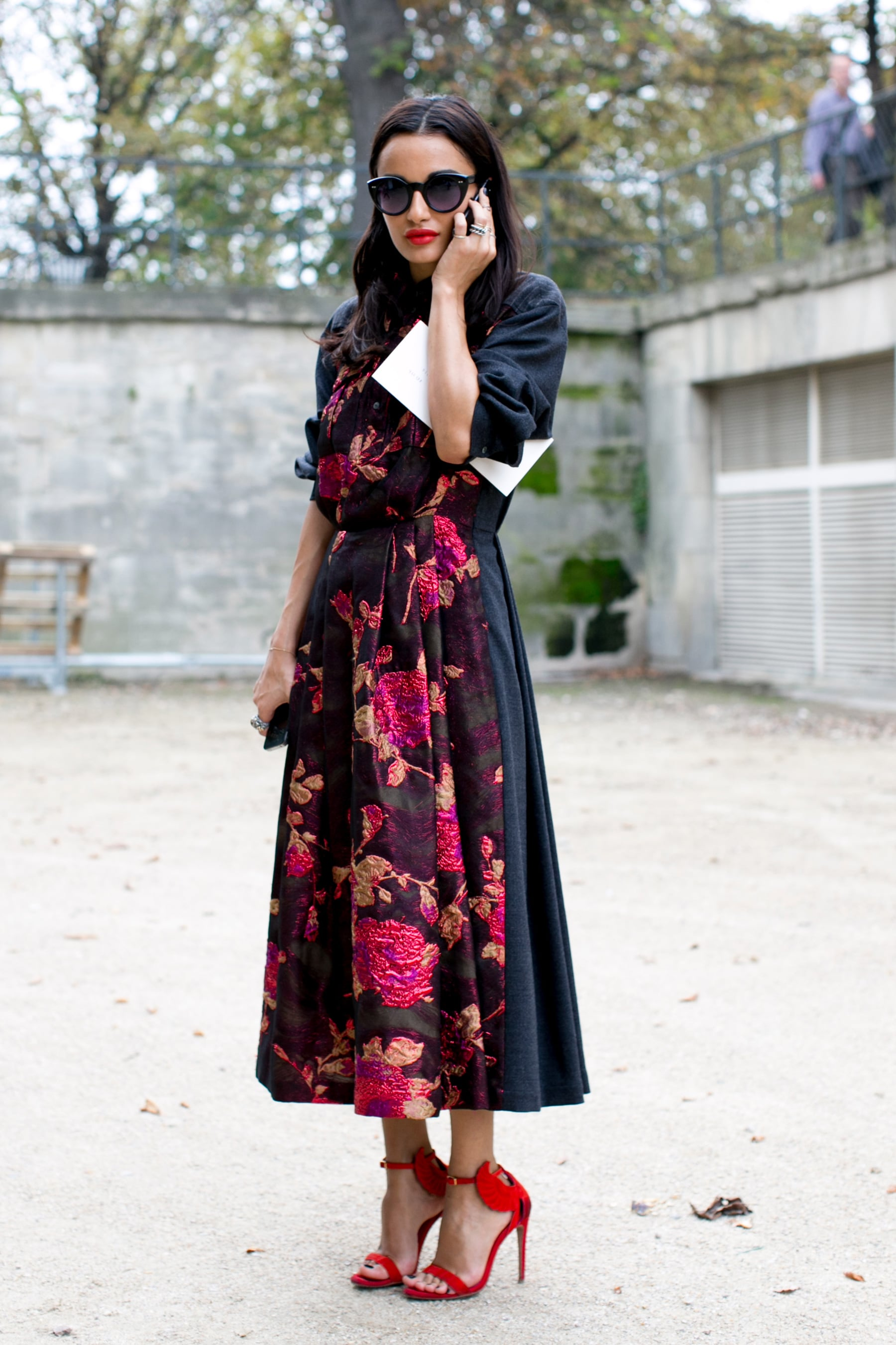 The perfect shade of red lipstick to match those flowers on her dress.