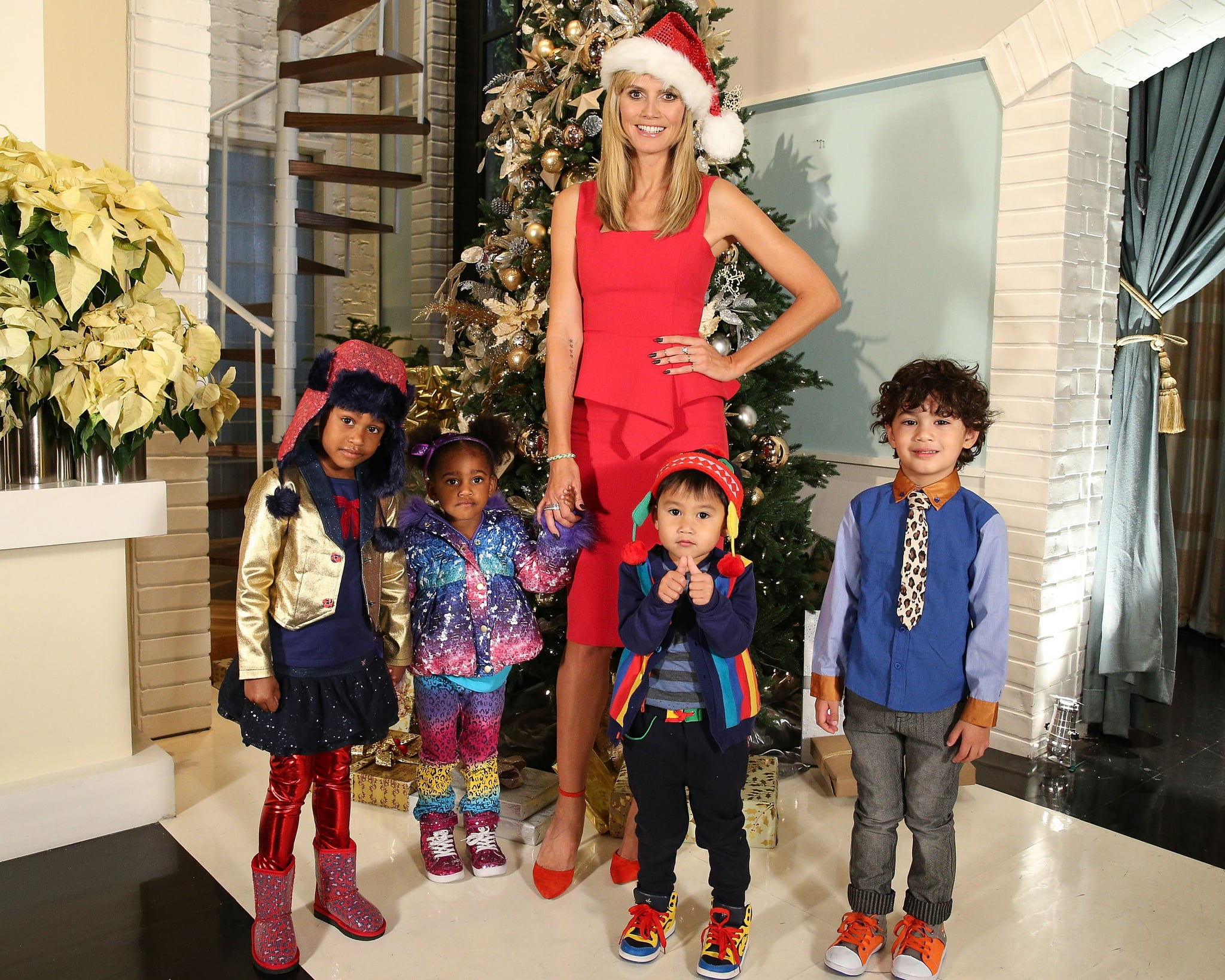 """No, those aren't Heidi Klum's little helpers — they're models for her Babies""""R""""Us collection!"""