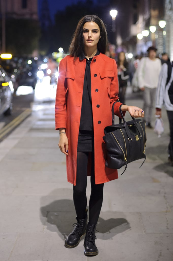 Her red statement trench coat and slick black Phillip Lim Pashli put the final refined touches on this Fall-ready ensemble.