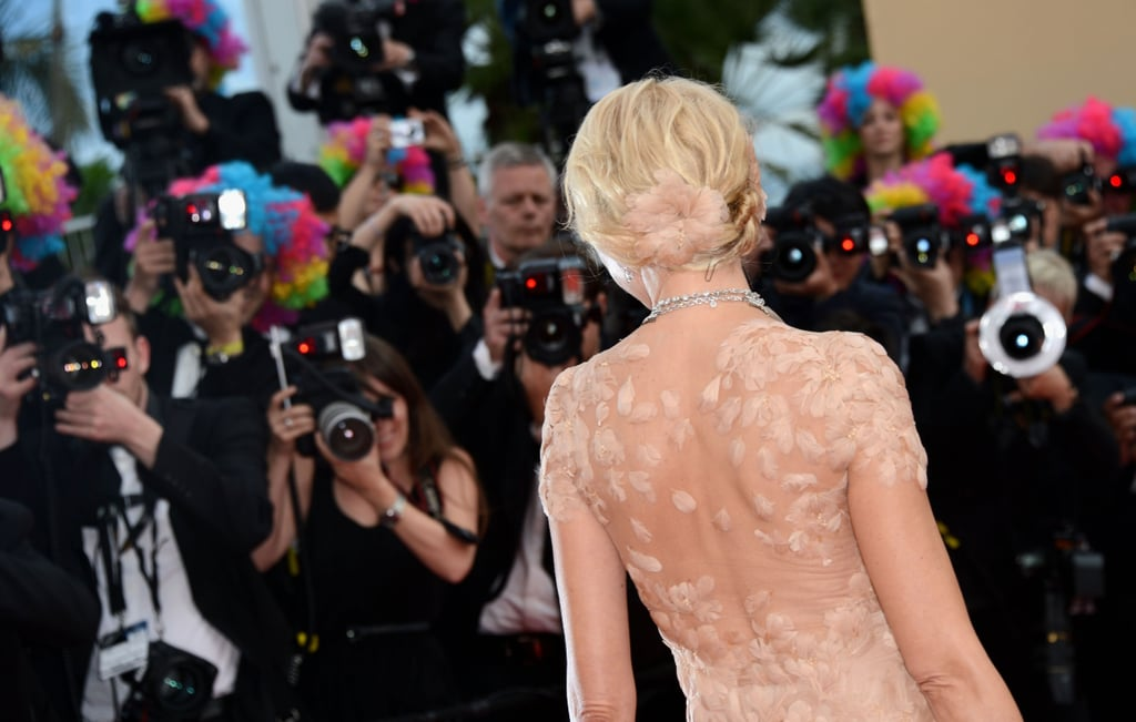 A stunning view of the back of Naomi's sheer-and-feathered Marchesa-clad back.