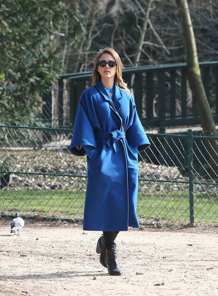 Jessica Alba's cobalt Kenzo wrap coat popped against the the greenery of a Parisian park. She completed her playdate style with leather Rag & Bone ankle boots and black shades.